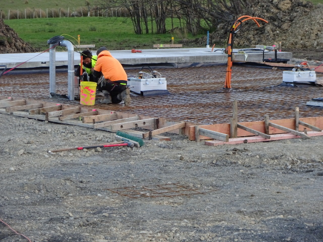 Men preparing for a concrete pour for the forecourt